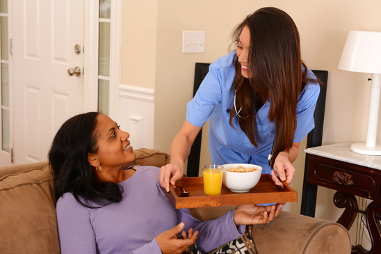 Home health care worker and an adult woman